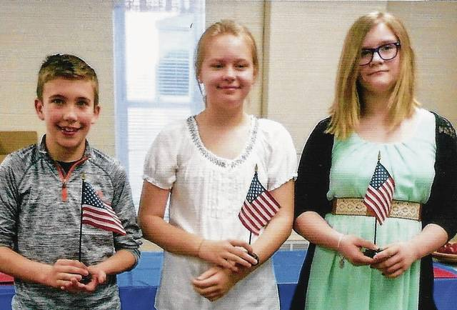 DAR essay winners are Matthew Westfall, first place, and Bailey Stapleton, second place, fifth graders from Mechanicsburg; Kylie Burgel, first place, seventh grader from West Liberty-Salem; and second place winner Grace Winters, WL-S, who did not attend.