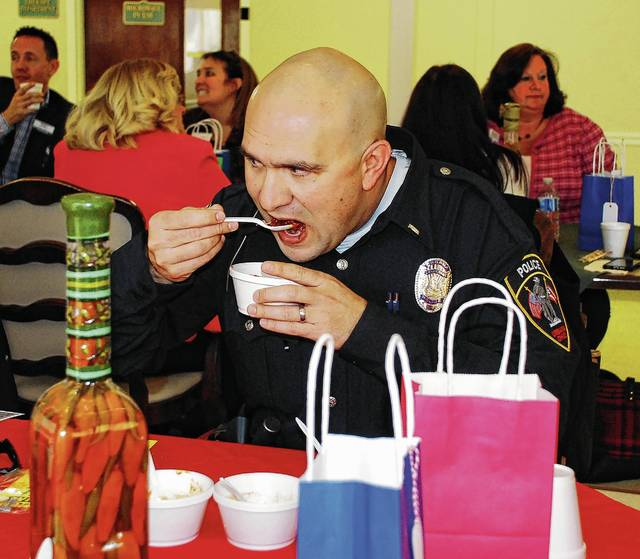 Urbana Police Lt. Josh Jacobs takes a bite of spicy chili during Thursday's annual Urbana Health & Rehab Center's Chili Cook-Off. Located at 741 E. Water St. in Urbana, the center was formerly Heartland of Urbana. The winning mild and spicy chili recipes will be served from 5 to 8 p.m. on March 23 during a chili supper and dessert auction at the center with all proceeds benefiting the Alzheimer's Association.