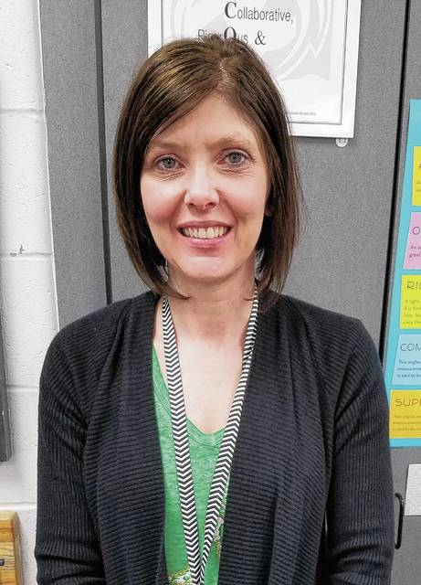 Graham Middle School teacher Tracy Merica will take a select group of girls to a summer program to learn leadership and presentation skills.