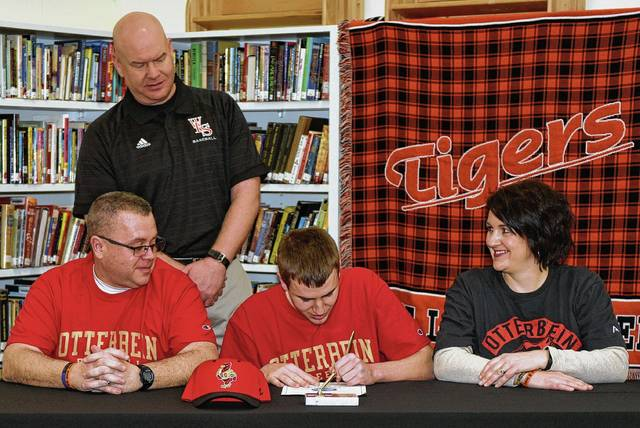 "West Liberty-Salem senior baseball player Tyler Louden signs his official letter of intent to play baseball at Otterbein University. He will major in Criminal Justice. Pictured are Louden with his parents, Rob and Allyson, and Tigers head coach Jon Payer. ""Tyler is a great kid, fierce competitor, great work ethic, and a pleasure to have on the team. He is a true leader on the field and in the classroom,"" said Payer."