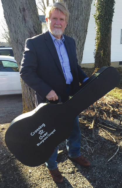 "Kenny Castle is a guitarist for Mechanicsburg's ""Crossing Over"" - a new Bluegrass Gospel Group."
