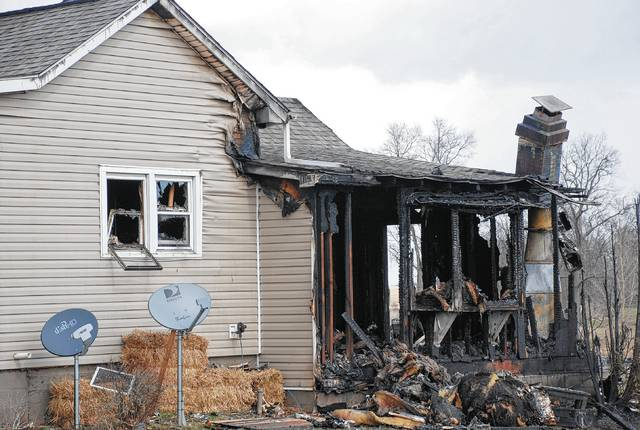 Fire damage is shown in this photo from Friday afternoon at 5517 Wesley Chapel Road, located northwest of Urbana. The fire is believed to have started in a wood-burning stove.