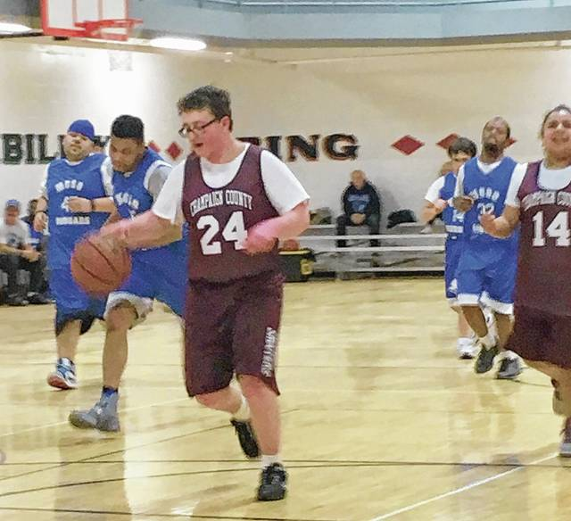 Drew Rizer competes in a recent Special Olympics basketball game this season.