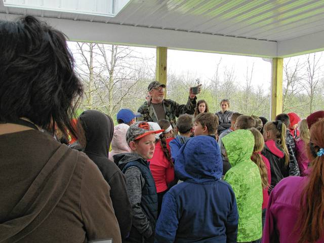 Jim Bartlett talks about caring for tree saplings during Cedar Bog's Earth Day event.