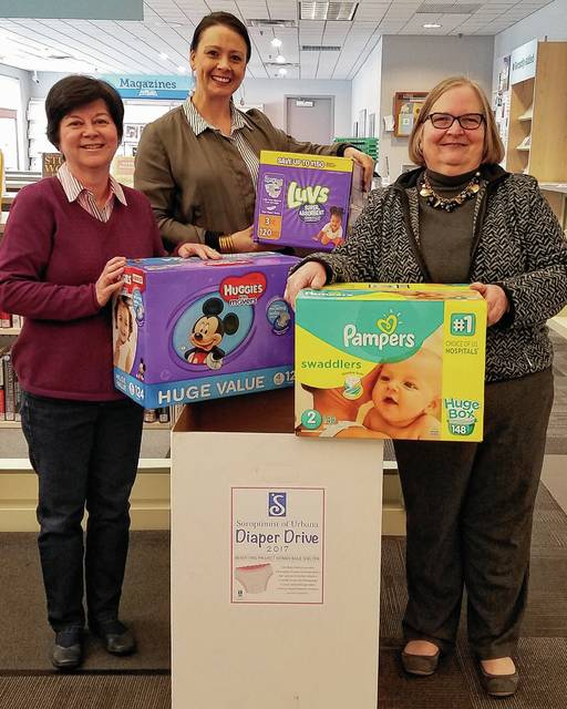 Promoting the Diaper Drive are, from left, Paula Arter, Emily MacKendrick and Kay Schenkel.