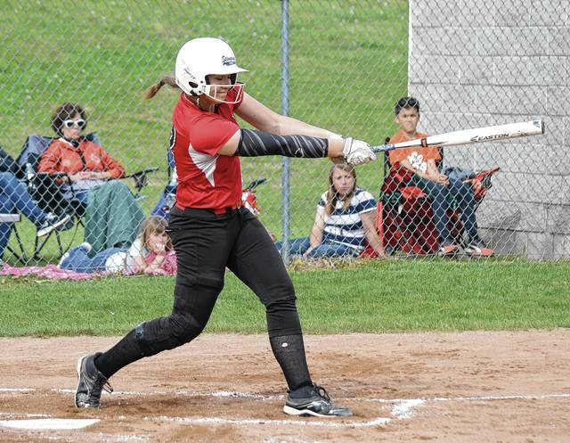 Triad's Abby Ehrenborg smacks a two-RBI double down the left field line on Friday against West Liberty-Salem.