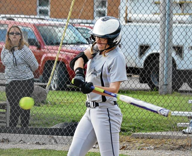 Graham's Ashton Curnutte smacks a ball back up the middle for a base hit on Thursday at Northeastern. During the game, Curnutte lost a prom-related bet when teammate Madison Bryant hit a home run.