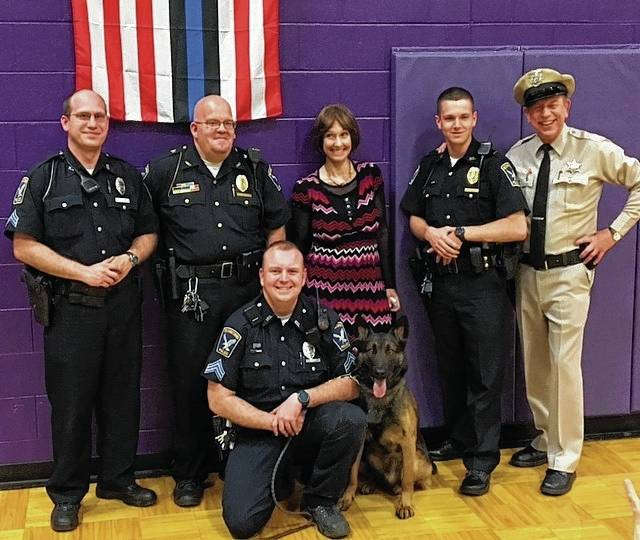 Karen Knotts, daughter of the late actor and comedian, Don Knotts, along with David Browning, a Barney Fife impersonator, brought a little piece of Mayberry to Mechanicsburg High School on April 15 for a fundraiser held to help the Mechanicsburg Police Department pay for its new K9 unit. Pictured, left to right, are: front row - Officer Nicholous Black and Max, the department's K9 in training; and back row - Officer David Patrick, Police Chief John Alexander, Knotts, Officer Cole Piatt and Browning.
