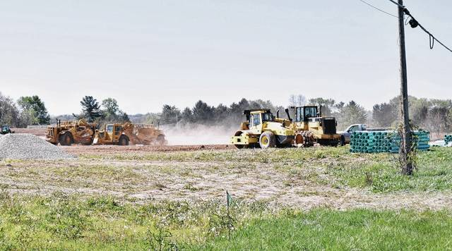 Construction workers move dirt and conduct other site work at the future location of the Urbana pre-kindergarten to eighth grade school on South U.S. Route 68. The district will hold a groundbreaking ceremony at 2 p.m. Sunday, April 30.