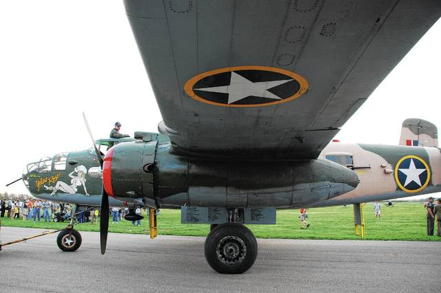 "In this <em>Daily Citizen</em> file photo, a B-25 Mitchell bomber makes its way down a taxi lane at Grimes Field during a gathering of the WWII aircraft in 2010. Known as ""Yellow Rose,"" the B-25 is operated by the Commemorative Air Force Central Texas Wing."