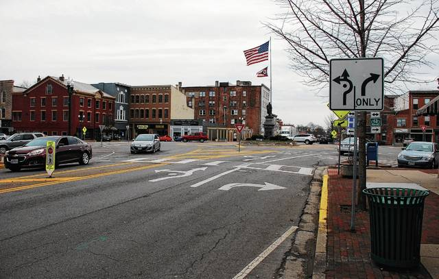 Two vehicles prepare to exit the downtown Urbana roundabout onto North Main Street. In 2019, construction is expected to start on a project aiming to make the intersection safer for both drivers and pedestrians.