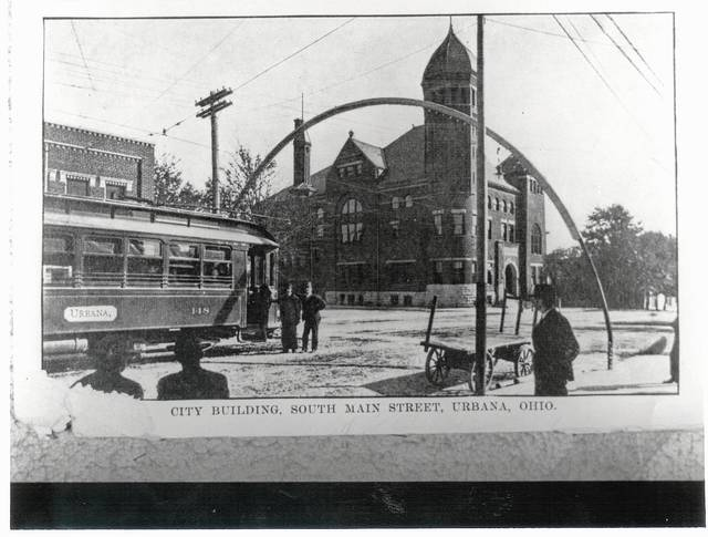 This circa 1905 post card shows the former Urbana municipal building and an interurban trolley car.