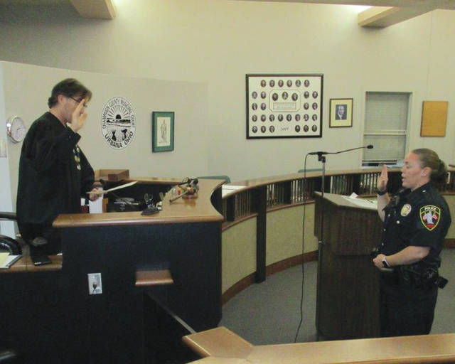 Officer Kerrie Kimpel is sworn in by Judge Gil S. Weithman on Wednesday. A 2003 Urbana High School graduate, Kimpel comes from a long line of family members who have served or are serving as Ohio law enforcement officers including her father Garry who previously served on the Urbana Police Division.