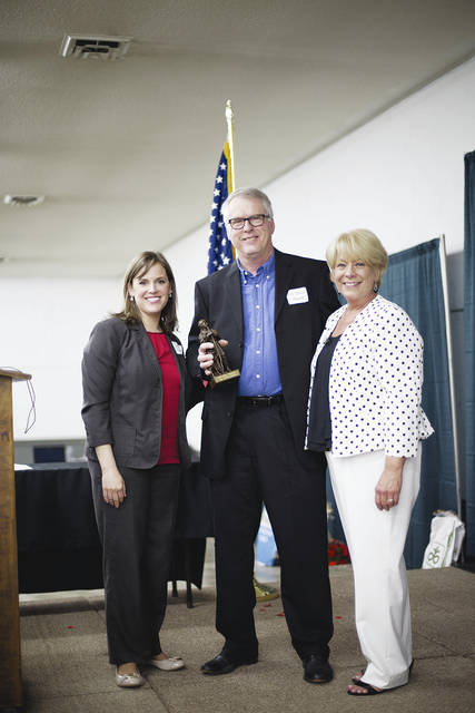2016 Simon Award Winner Dr. Dave Smith stands with 2015-16 Chamber Board President Jennifer Tollefson (left) and former Chamber Executive Director Sandi Arnold (right).
