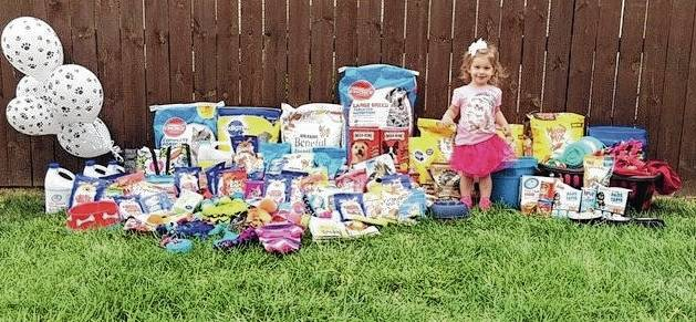 Two-year-old Eloise McKinnon is delighted with the gifts she received at her birthday party on behalf of animal shelters.