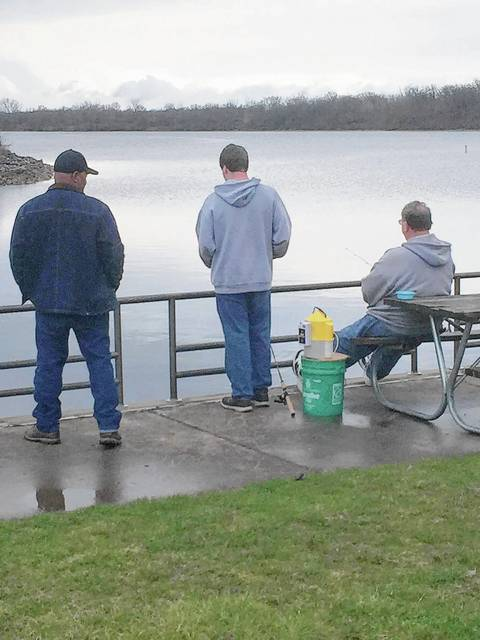 Anglers fish off the dock of the bay on a recent misty day at the Buck Creek State Park marina at C.J. Brown Reservoir in Springfield.