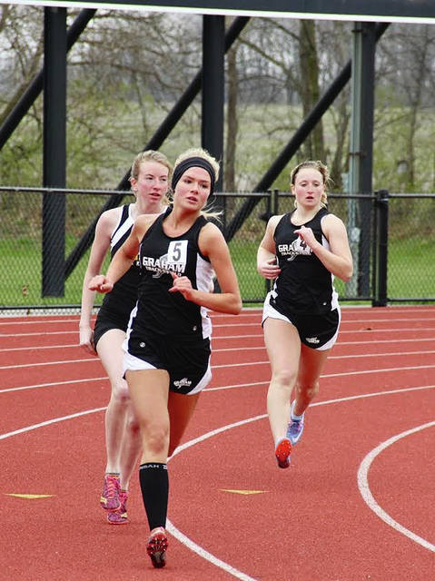 Graham's Roxie Conn and Taylor White compete at the Tecumseh Invitational on Saturday.