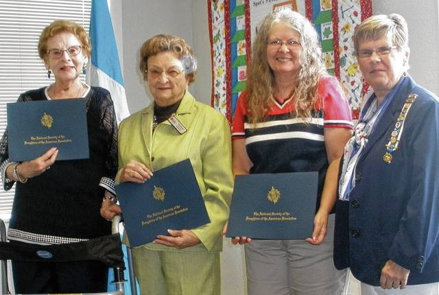 Certificates for years of membership were presented to, from left, Fonda Lou Eaton, 50 years; Frieda Roesser, 25 years; Deborah Ruchty, 10 years; and Regent Patricia Detwiler, presenter. Kay Petty, 25 years, was not present.