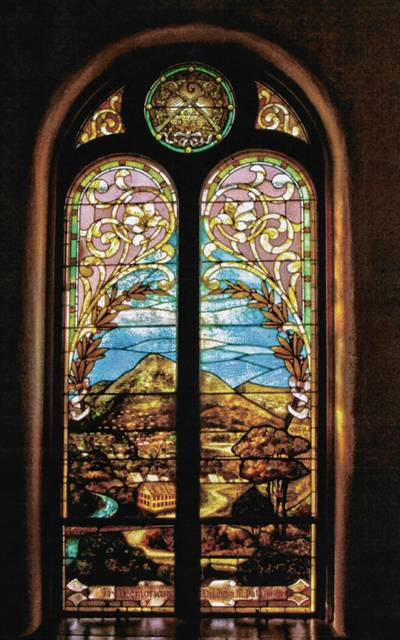 This stained glass window in the First Presbyterian Church in Urbana was given as a memorial to William M. Patrick, who died in a Civil War battle. The window shows a Union Army camp with, railroad tracks and soldiers' tents.