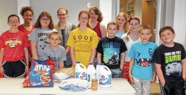 The Designing Kids 4-H Club of St Paris collected donations for PAWS Animal Shelter for a Community Service Project. Pictured are Hunter DeMarco, David Peters, Carter DeMarco, Carson Copeland, Lauran Bailey, Macy Peters, Allison Jenks, Joelle Christman, Kylee May, Alyssa Gilreath, Madilyn Jenks and Kelsey DeMarco.