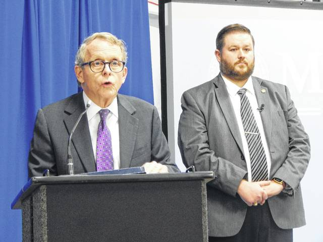"Ohio Attorney General Mike DeWine, left, introduces the new ""advanced training village"" of virtual training facilities for police officers at the Ohio Peace Officer Training Academy in London."