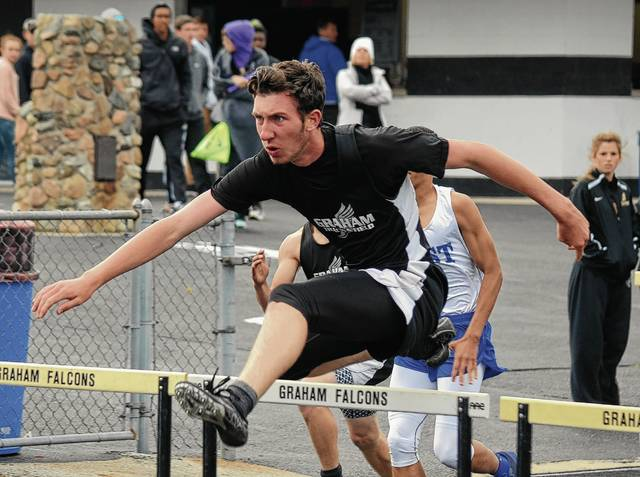 Graham's George Bugg has excelled at the hurdles all season. He won last week at a home meet (pictured) and took home a second and a third at the conference championships held Friday.