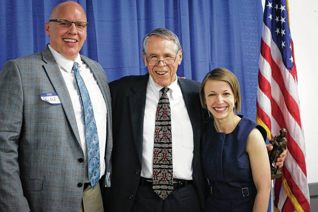 During the Champaign County Chamber of Commerce's annual dinner held on April 28, Judge Roger Wilson, middle, was honored with the Simon Award. Pictured alongside Wilson are Paul Waldsmith, chamber board president, and Lydia Hess, chamber executive director.