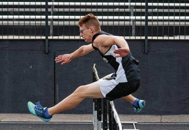 Graham's Timothy Hughes leaps over a hurdle during the boys' 110-meter hurdle race on Tuesday at Graham.