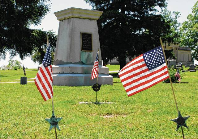 Surrounded by grave markers and U.S. flags at Maple Grove Cemetery in Mechanicsburg stands a memorial dedicated by Donald Cannon Post 238 (American Legion) to those who died during World War I.