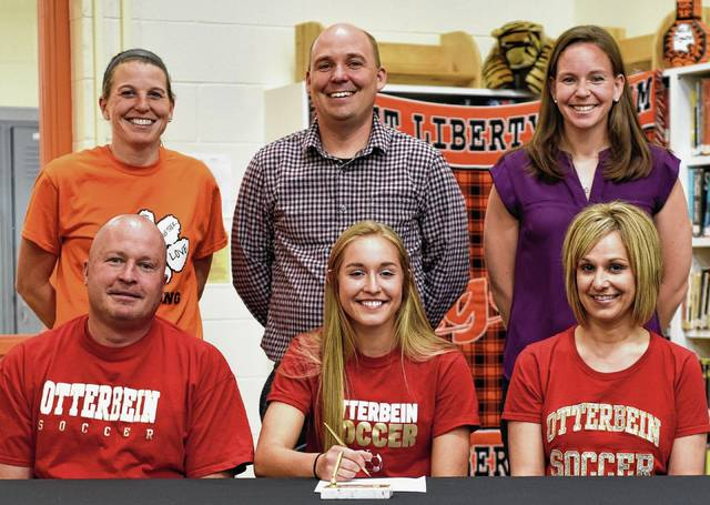 West Liberty-Salem senior soccer player Ashley Rabenstein signed her official letter of intent to play soccer at Otterbein University. She will major in nursing. She is shown here with her parents and coaches, Kim Hollar, Andy Cotrell and Jess Witzky.