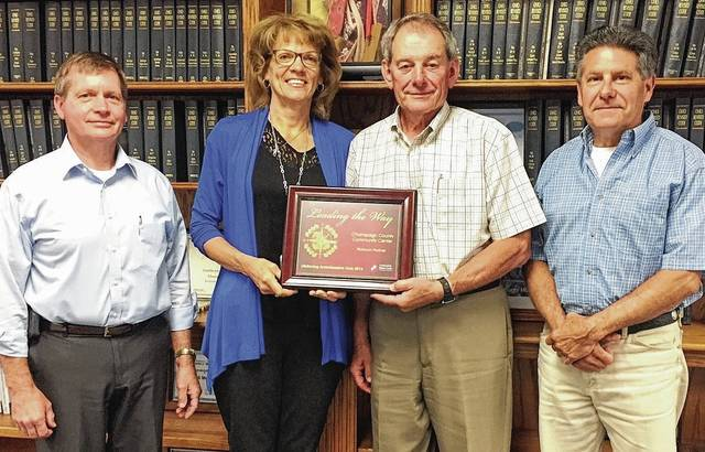 The Community Blood Center's Kathy Pleiman presented the 2016 Platinum LifeSaving Ambassadors Award to the Champaign County Commission. From left are Commissioner Steve Hess, Pleiman and Commissioners Bob Corbett and David Faulkner. CBC recognized the county Community Center for earning the Platinum award for blood drive excellence in 2016, the highest recognition in the CBC LifeSaving Ambassadors Club. Sponsors must average 100 percent or higher for blood drive collection goals to achieve the honor. The county Community Center hosted six blood drives in 2016 resulting in 195 donor registrations and 166 blood donations.