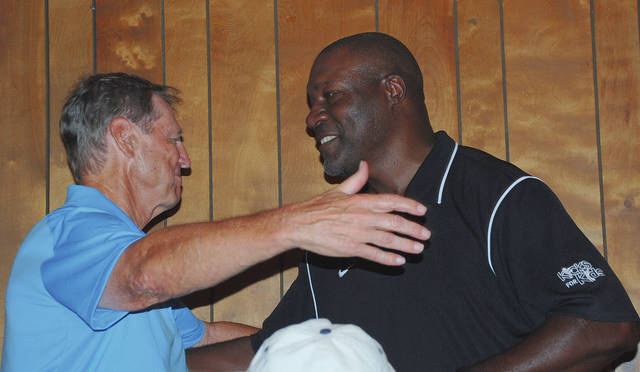 Pro Football Hall of Famer Dick LeBeau (left) hugs former Cincinnati Bengals' safety David Fulcher during the 2015 Dick LeBeau Legends Golf Classic at Mitchell Hills Club in Springfield. LeBeau coached Fulcher when both were with the Bengals in the 1980s.