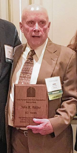 John Atkins is pictured with his 50-year membership award.