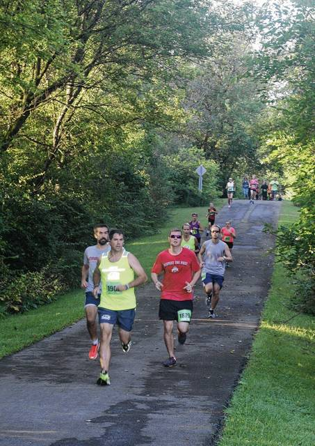 Runners in a previous Serve A Soldier 5K are on their way to Melvin Miller Park on the Simon Kenton Trail after starting at the Champaign Family YMCA. Registration is open for the 2017 Serve A Soldier, to be held Saturday, Sept. 2.