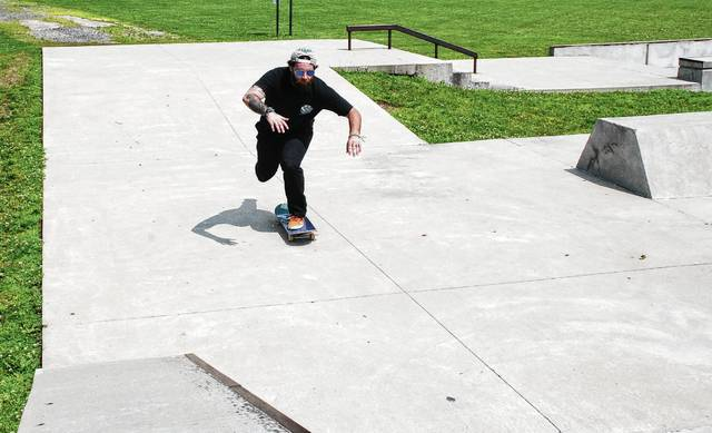 Cody Rowlands enjoys a summer afternoon on the skateboard ramps at Melvin Miller Park in Urbana.
