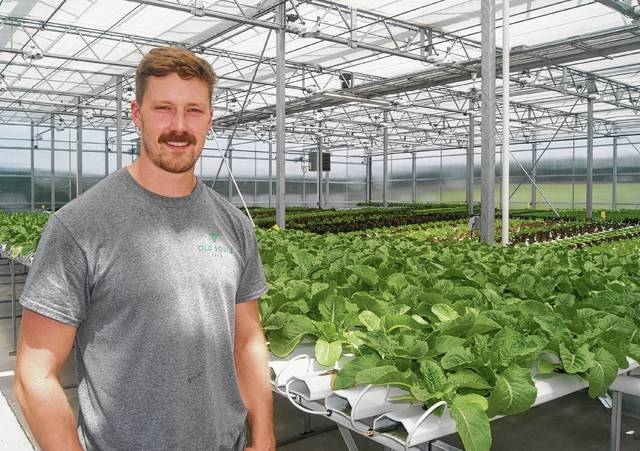 Vic Kaczkowski is shown in the greenhouse of Old Souls Farms, which he owns and operates with Ethan Snyder near St. Paris.