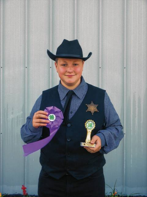 Creative Costumes - Leo Compton (State Fair Delegate & Rosette & special nomination to state fair-Jr. Master Clothing Educator nominee)