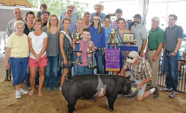 Summer Doty's Grand Champion Overall Market Gilt sold for $1,650 to a syndicate of buyers.