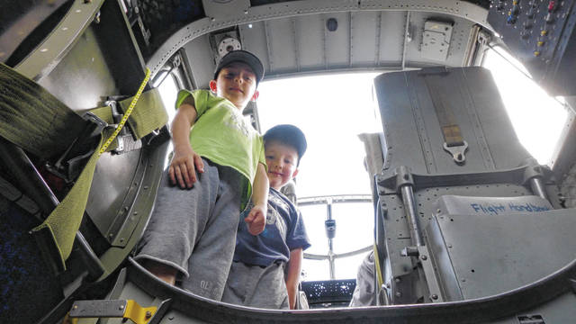 Keaton Thompson (left) and his brother Corbin Thompson, of Springfield, take a tour of the inside of a B-25 Mitchell on Saturday.
