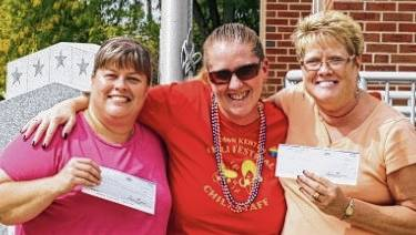 From left are Christy Bailey, second place winner, Alyssa Dunham, Chili Festival Committee member, Wanda Jenkins, first place winner.
