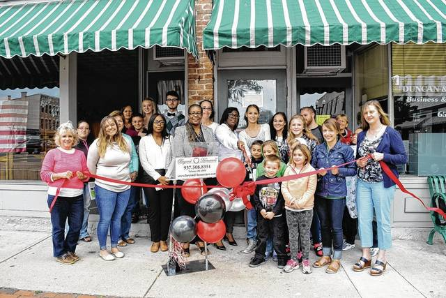 The Champaign County Chamber hosted a ribbon-cutting to welcome Beyond Homecare (31 ½ Monument Square) to downtown Urbana on Sept. 1. From left are Vicki Deere-Bunnell, Cathy Carpenter, Hannah Tukesbrey-Kilbride, Marcia Bailey, Madge Earles, Jake Stump, Courtney Stump, Zakyah Oglesby, Shawn Stump, Ella Davis, Trinda Kaminski, co-owner Shawana Bonner, co-owner Jessica Thomas, Ryan Reak, Anjellica Carpenter, Chadwick Carpenter, Destinee Bilotta, Lacie Thomas, Kelsie Carpenter, Ava Carpenter, Ryan Godshall, Chamber Director Lydia Hess, Liela Anderson and Carissa Sellman-Luza.