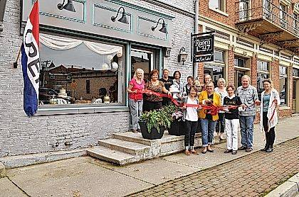 The Champaign County Chamber hosted a ribbon-cutting Oct. 6 to celebrate the new downtown businesses Let's Eat Cake and Room 117. Pictured from left to right in the back row: Patsy Thackery, Terri Thompson, Rita Anderson, Jenny White, Karen Mahan, Katherine Funderburgh, Tonya Woodruff, Pat Thackery and Sarah Thornton. Pictured from left to right in the front: Lydia Hess, Champaign County Chamber executive director, Tina Knotts, owner of Let's Eat Cake and Room 117, and Lynne Davisson.