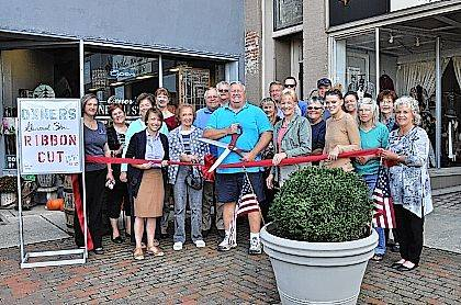 The Champaign County Chamber hosted a ribbon-cutting Sept. 28 to celebrate the grand opening of the downtown business Oxner's General Store. Shown are, back from left, Carissa Luza, Gina Mokry, Marcia Bailey, Robbin Ferryman, Jerry Osborne, Yale Cline, Marian Vance, Jamon Sellman, Mike Short, Linda Butler, Ryan Berry, Hannah Killbride, Patty Hawkes, front from left, Lydia Hess, Chamber executive director, Catherine Gates, Mike Manaloff, Oxner's General Store owner, Mary Manaloff, Sarah Thornton, Patsy Thackery and Vicki Deere-Bunnell.
