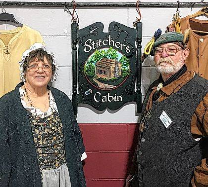 Tim and Sharon Milligan of Stitcher's Cabin are an integral part of Christiansburg's bicentennial planning, including a primitive 1800s encampment.