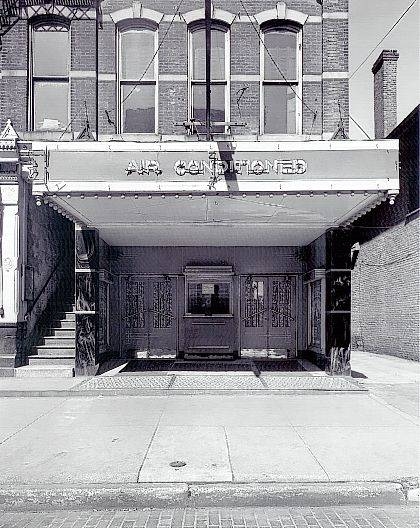 This is a circa 1952 photo of the outside of the Lyric Theater at 110 S. Main St., Urbana. Note that the theater was air-conditioned. The theater was in operation from 1910 until 1952. In 1953 the building was occupied by Urbana City Offices including Police Dept. and Mayor's Office. Later an Ohio State Liquor store was located in the building. (Champaign County Historical Society #A318)