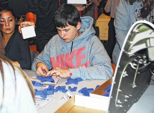 Nate Clem, an Urbana High School student, helps construct an airplane from Legos during the 2016 national Manufacturing Day held at the Urbana University Student Center. His exercise was part of a Honeywell Aerospace demonstration on how to make the manufacturing process more efficient. Dozens of high school students and several Champaign County manufacturers attended the 2016 event held in celebration of national Manufacturing Day. This year's event will be held Friday, Oct. 6.
