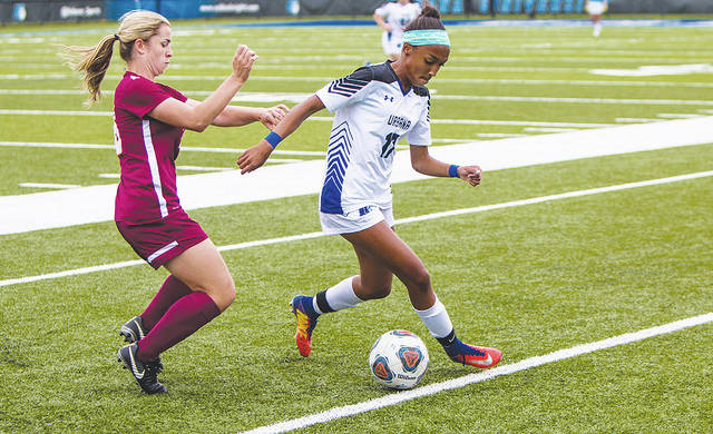 UU's Alyssa Edwards (right) possesses the ball against visiting West Liberty University on Wednesday.