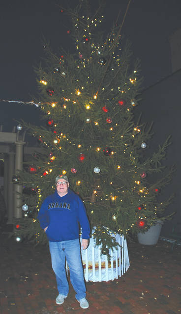 Urbana Mayor Bill Bean thanked the carolers and made a few comments before lighting the Christmas Tree at Legacy Park on Monument Square, Nov. 24. A crowd of about 50 people crowded around him for the ceremony, and also enjoyed vendors such as Scmidt's Sausage Truck, a Marco's Pizza tent, N&H Kettle Corn, Boy Scouts of America selling hot chocolate and Top Knots of Bellefontaine selling hand knit aprons and hats.