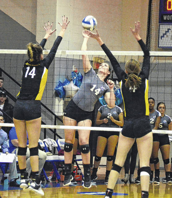 Urbana University's Madison Davis (14) spikes a ball between a pair of West Liberty University defenders on Friday at the Grimes Center. West Liberty won the match, 25-19, 25-16, 17-25, 25-18. For UU, Katlynn Dunlap had 14 points and 14 kills and Deandra Atwood had 27 assists. In men's basketball Friday night, UU lost its season-opener to Indiana University of Pennsylvania, 93-60. Ethan Snapp had 13 points to lead the Blue Knights.
