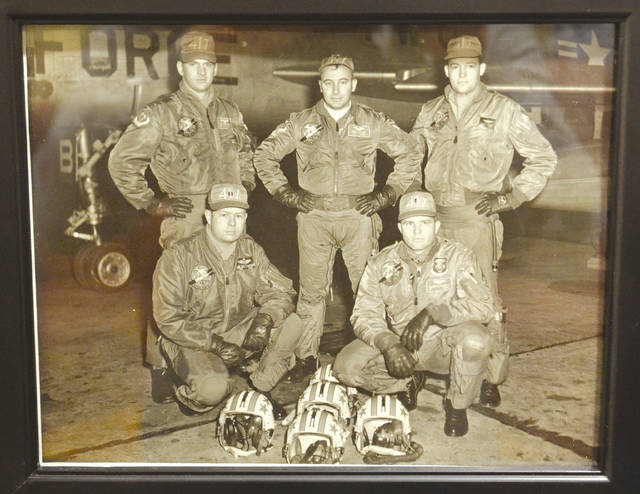 This photograph shows Paul Kari (center) and four members of his squadron prior to his seven-year detention in North Vietnam.